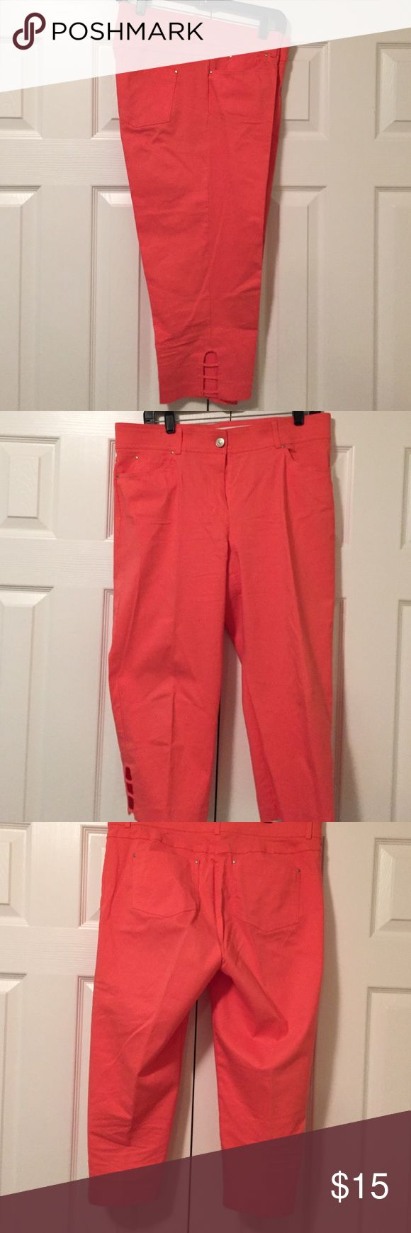 Beautiful coral Capri Beautiful coral Capri, hugs curves well! Very comfortable. Rayon/nylon/spandex blend. Front and back pockets. Bottom of pants have cute peek-a-boo window slits, giving them that extra flare! Spring/summer must have! Verve Pants Capris