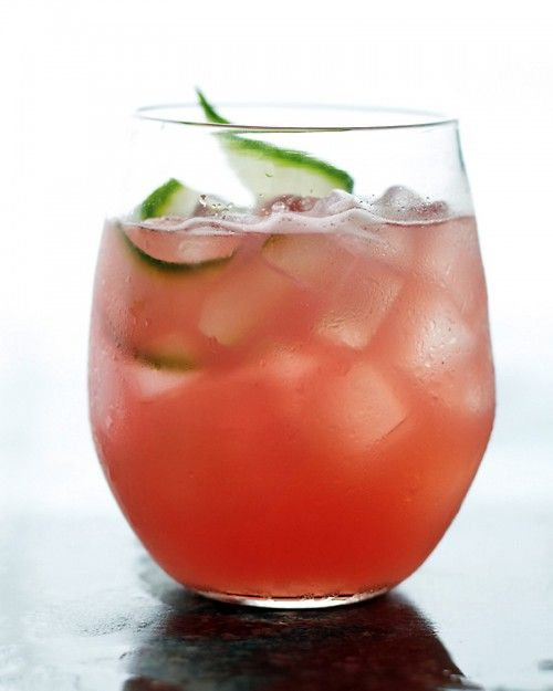 Watermelon-Cucumber Cooler  5 cups cubed seedless watermelon (about 1 1/2 pounds)  1 large English cucumber, peeled and cut into chunks  1/4 cup fresh lime juice (from 2 limes)  2 tablespoons honey  2/3 cup vodka  Ice  Cucumber slices, for garnish