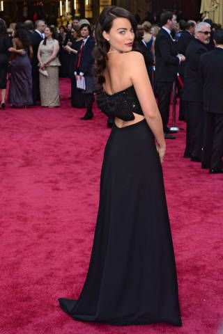 When I first saw Margot Robbie tonight, I did not recognize her. I assumed that she had dyed her hair in an attempt to audition for American Horror Story: Coven. However, when the initial shock wore off, I was able to appreciate her Saint Laurent gown in all it