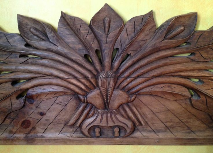 Hand carved Mexican calla lily bed board.
