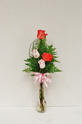 Eva's four bloom standard rose bud vase with bear grass embellishment
