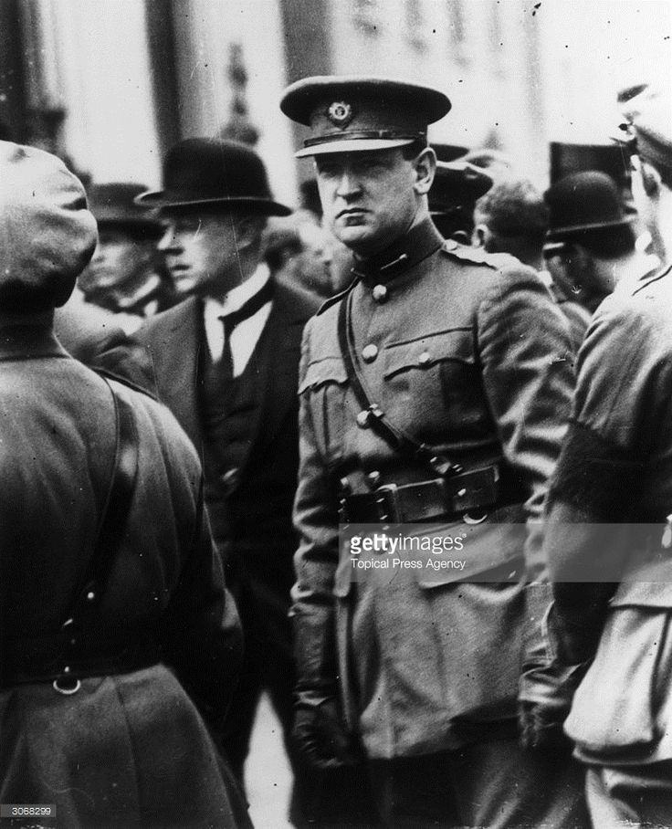 12th August 1922: Irish politician and Sinn Fein leader Michael Collins (1890 - 1922) attends the funeral of the Irish Free Stater and founder of Sinn Fein, Arthur Griffith. One week later Collins was killed