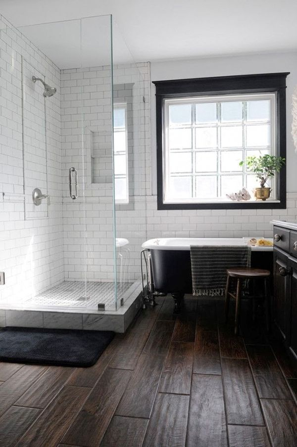 Masculine Bathroom with Porcelain Wood Plank Flooring, Marble, Subway Tiles, Glass Shower Enclosure, and Clawfoot Tub.
