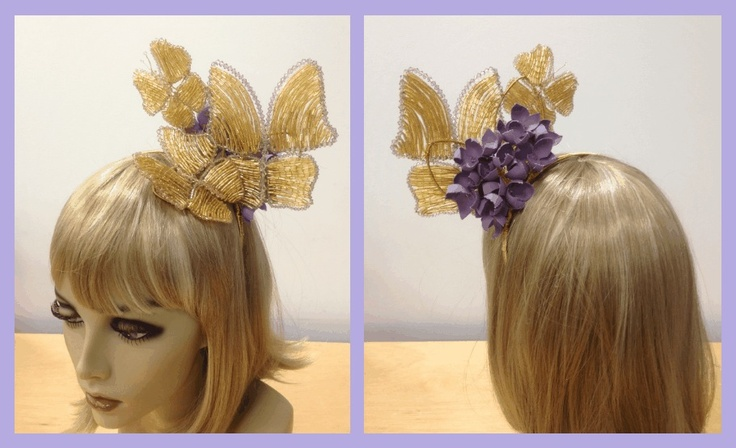 Designed by Leila Koster Millinery. This is my newest design, the front features completely hand beaded Butterflies featuring Swarovski Crystals. the back view features hand made Hydrangea blooms with Swarovski Crystal centres. Inspired by my Grandmothers sunny green gardens.