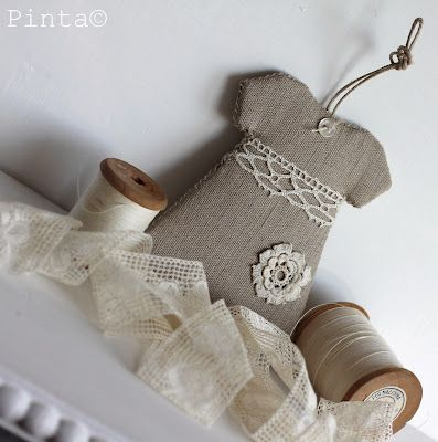 how about little burlap dresses on a small white tree ? burlap