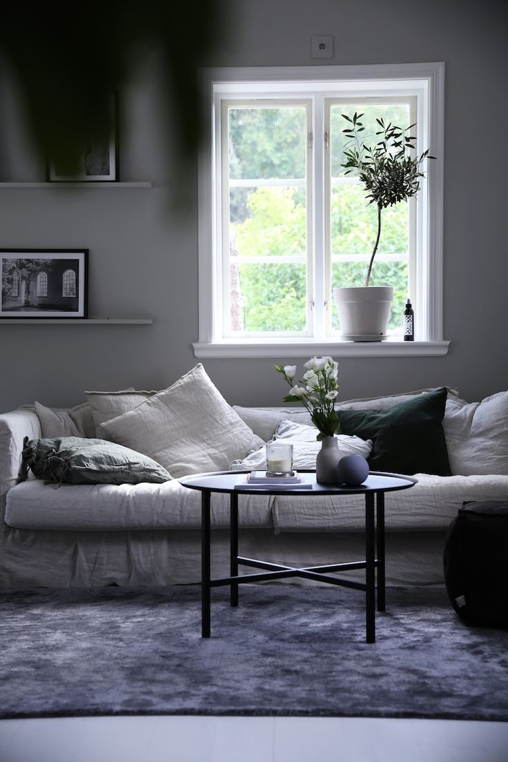 my scandinavian home: Grey and linen sitting room in a beautiful Swedish family home /photo - Emily Slott