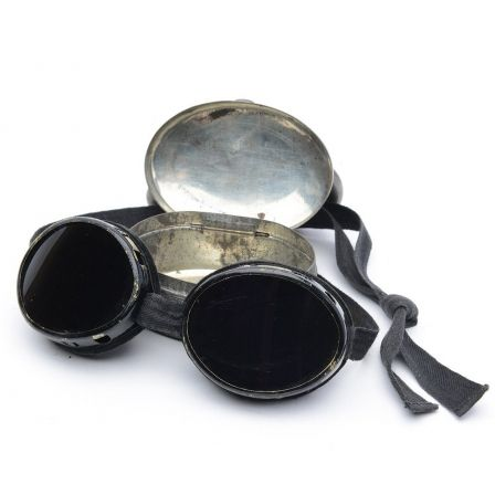 Beautiful antique Swiss 1920's glacier goggles. They come in the original metal tin. Used in good condition, vented eye pieces and cloth tie on strap.