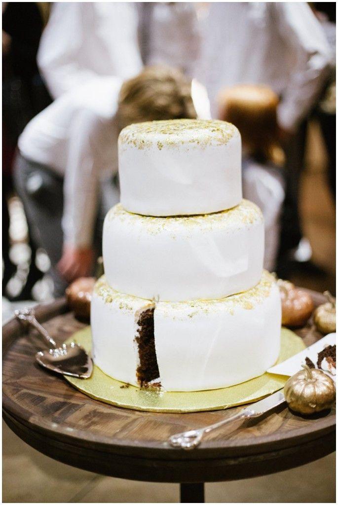 Amy Hirschi Photography || Wedding cake || Gold Wedding Cake || Gold Flakes on wedding cakes || Utah Wedding || Cutting the cake || Cake smash || Utah Wedding Photographer || Utah Photographer || Wedding reception || Boho Wedding || Modern Wedding || Hugging || Candid wedding || Wedding decorations || Dried flowers || Harry Potter Wedding || Gold || Gold Wedding || Pumpkins || Fall Wedding || Curly Hair || Long hair groom || Autumn Wedding || DIY Wedding || @eerb