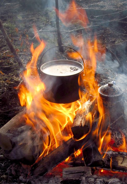 a campfire meal and coffee