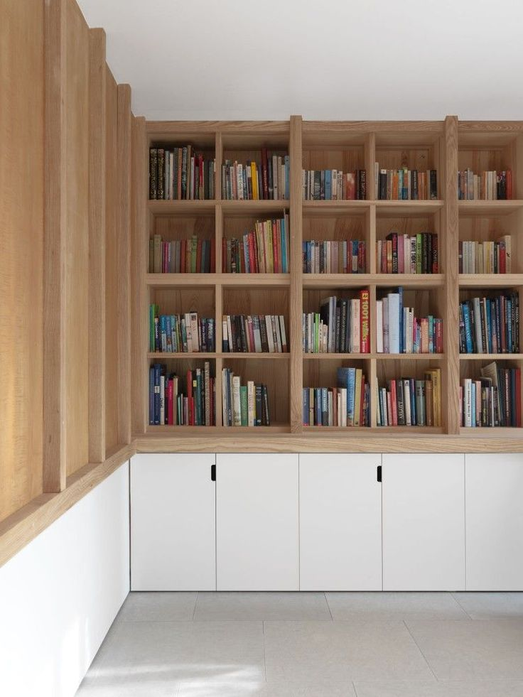 McLaren.Excell. Flat faced cupboards below the shelves lighten this look, and calm the visual busy-ness that is usual with books and shelved objects