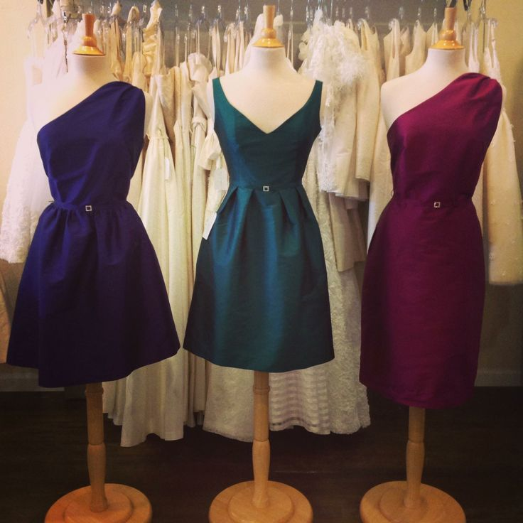 A mix of jewel tones can make for a perfect wedding color palette.  Shown here are dresses by Anna Elyse in Pansy, Emerald and Peony Taffeta.