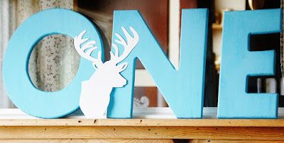 The Big ONE first year birthday theme party ~ Elk Head ~ O N E Wood Letters with deer / elk head paper cutout ~~ Little Buck Party ~ Woodland Party ~ Camo Party ~ Hunting Party ~ www.KendollMade.com