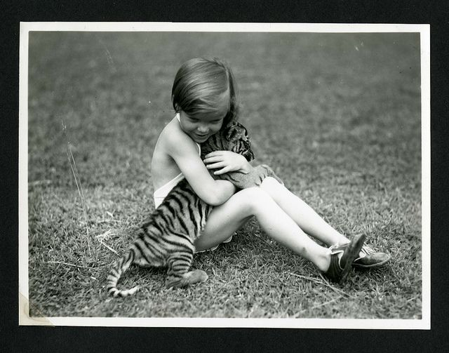 Unidentified child with tiger cub photographed during the the National Geographic Society-Smithsonian Institution Expedition to the Dutch East Indies, 1937 by Smithsonian Institution, via Flickr
