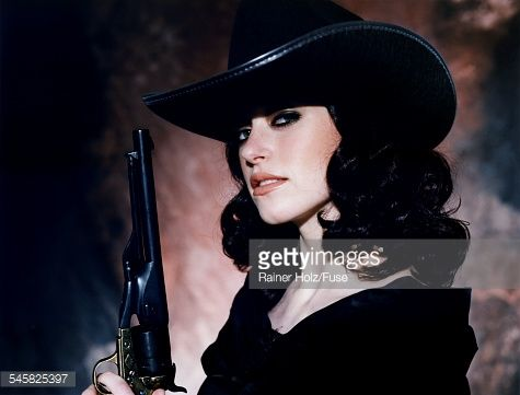 Young Woman in Black Cowboy Hat with Pistol