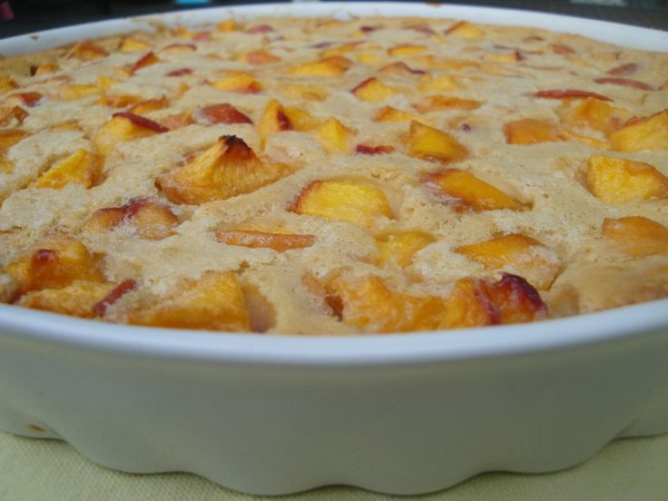 "Peach Clafoutis (French dessert) ""very low in sugar and flour, and has a nice custardy base to highlight whatever fruit happens to be in season: peaches, plums, pears or the traditional cherries. It's not overly sweet or rich; ...a cross between crepe batter and a custard."""