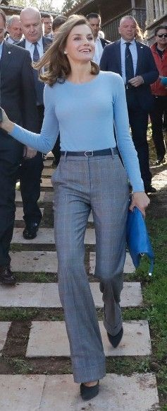 Queen Letizia sported a semi-professional look consisting of her cornflower blue Hugo Boss sweater and a new pair of grey Massimo Dutti Checked Wide-Leg Trousers.