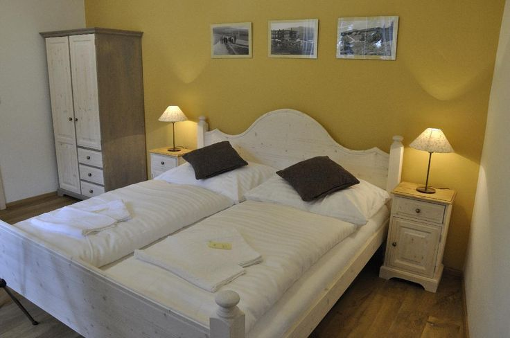 Ložnice ve světlém provedení - Grand Apartments, Špindlerův Mlýn