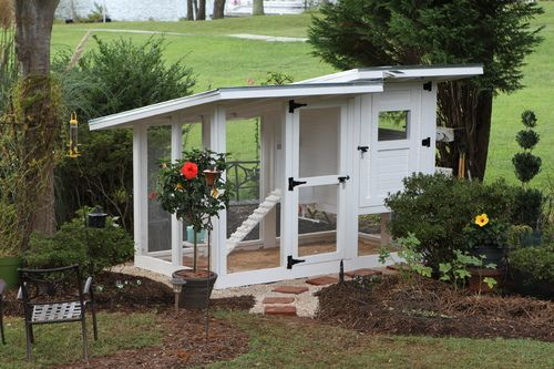 Super cool chicken coop!!  lots of pictures of the building process, great feeder & watering ideas etc......