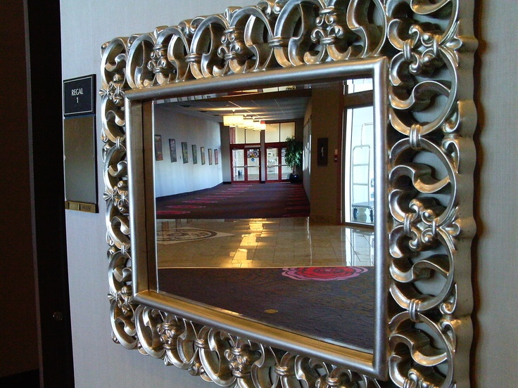 Mirror, mirror on the wall...    There are plenty of stylish mirrors along the indoor plaza - your chance to make sure every hair is in place before making a grand entrance into the ballroom.