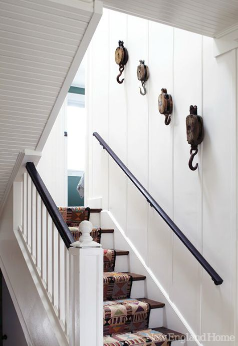 Collection of pulleys going up the stairs from New England Home #gallerywall #decorating #decoratingideas #andersonandgrant
