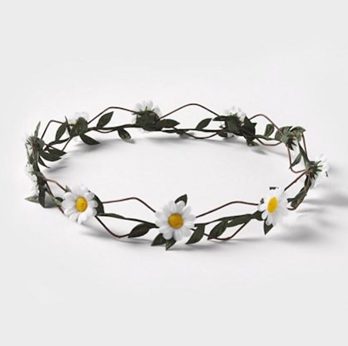This daisy headband has simple beauty. Claire's Ring O' Daisies Headband, $8.50, claires.com