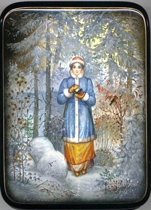 Russian lacquer miniature from the village of Fedoskino. Snegurochka (Snow Maiden) with two bullfinches in the winter forest.