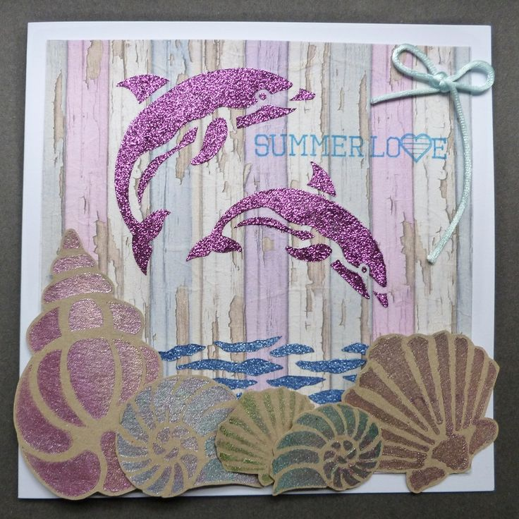 'Summer Love' card. - Imagination Craft's - Rice paper 336.  Dolphin & Shells stencils.  Decoupage glue.   Starlight paints - Pink sunset, Silver gold, Menthol, Diamond & Jade.  Sparkle Mediums - Lapis blue and Old rose.  Metal spatula.  Stazon pad - Azure.   May 2016.