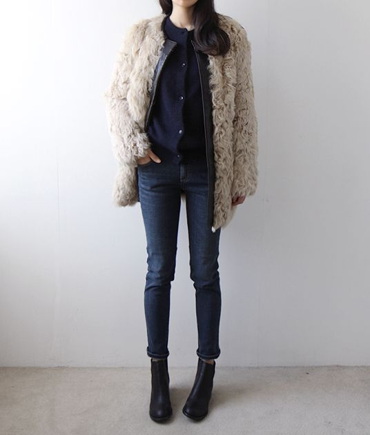 Fur coat, tight jeans and boots.
