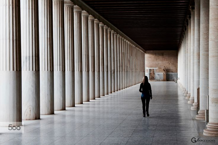 Walking through the columns at the Stoa of Attalos in Athens, Greece.
