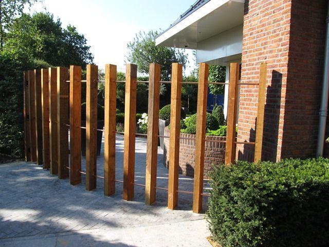 забор из бруса с перемычками