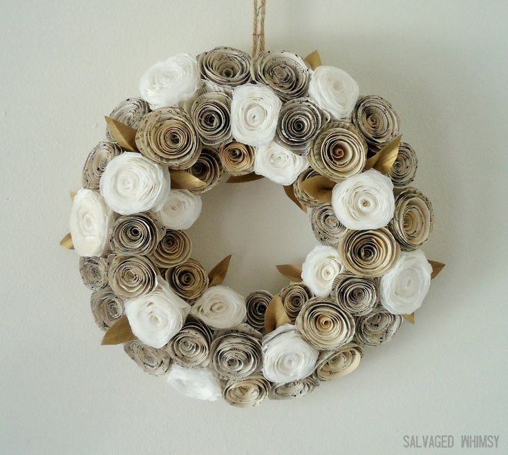 This wreath is made from coffee filters and pages from old books.