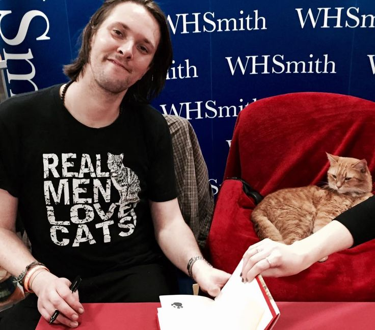 Bob and James in his awesome Tshirt at a book signing in Leicester - from FB page James Bowen & Street Cat Bob