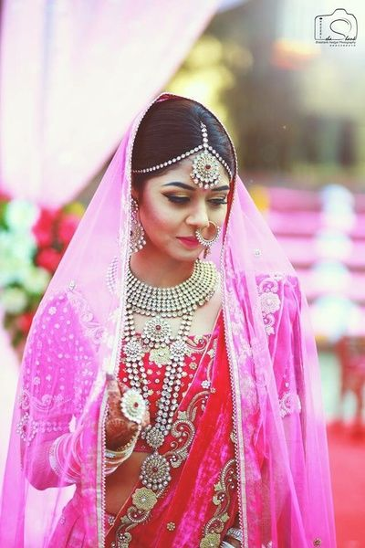 Indian Wedding Jewelry - Silver Indian Wedding Jewelry with Fuchsia Pink Blouse and Lehenga with Light Pink Net Dupatta #wedmegood #indianbride #indianwedding #pink #lehenga #silverjewelry