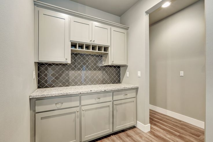 Gorgeous Built in Butlery. Painted Sherwin WilliamsDorian gray, quartz counters and Arabesque Backsplash (Bedrosians Mallorca Glass) with light gray grout. #greatnwhomes @bedrosianstile