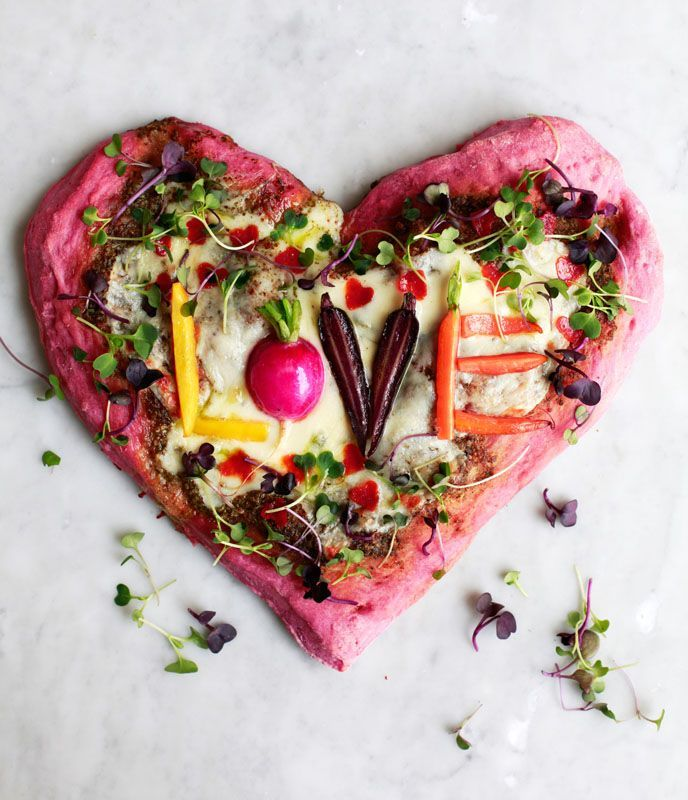 Celebrate this Valentine's Day with a pink heart-shaped pizza. The crust gets its natural coloring from pureed beets blended into the dough. Load up the pizza with the toppings of your choice: mini pepperoni pieces cut into hearts, or baby vegetables that you use to spell words of romance. Or both!