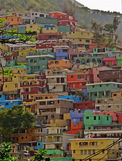 (19th May 2015) ANY SPACE WILL DO: Port-au-Prince, Haiti. Shelves of bright houses obscure the hill.