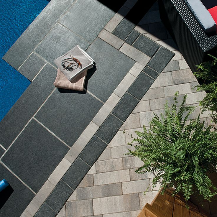 Poolside patio. Project application combining Presidio and Matrix Finish pavers.  Colors: Presidio Champagne and Matrix Finish Ravenstone Black by Oaks Landscape Products.