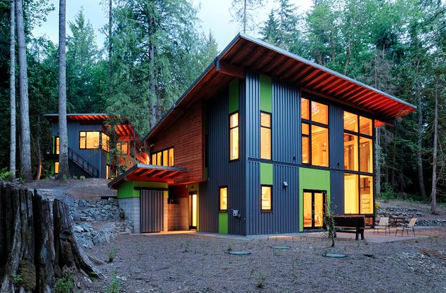 7 Popular Siding Materials To Consider: Mixed Siding: Blue Corrugated Metal, Smooth Green, Natural