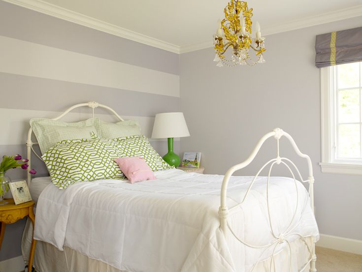 source: Graciela Rutkowski Interiors    Purple, lilac & green girl's bedroom - lilac tone-on-tone painted accent wall, white metal bed, white 7 green trellis shams, mismatched vintage nightstands, purple roman shade with chartreuse Greek key ribbon trim and kelly green gourd lamp.