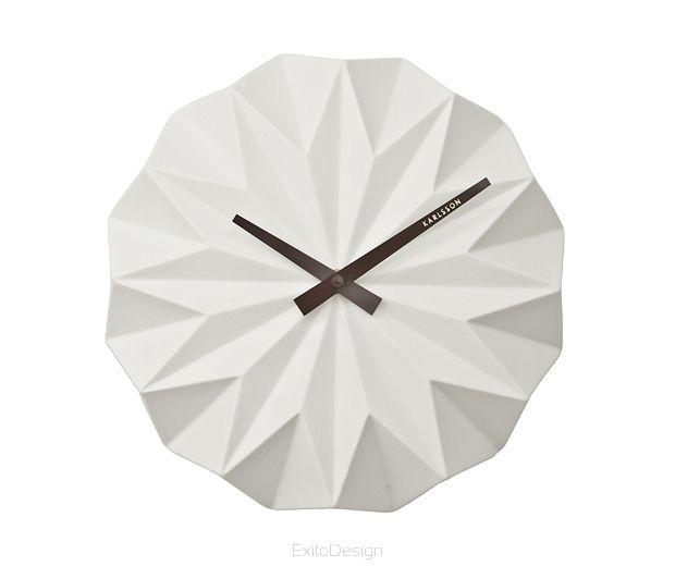 Kolor: biały Wymiary: średnica 27 cm, grubość 6 cm  Materiał: ceramika  Zasilanie: 1 szt. AA, brak w zestawieZegar posiada niesłyszalny mechanizm.