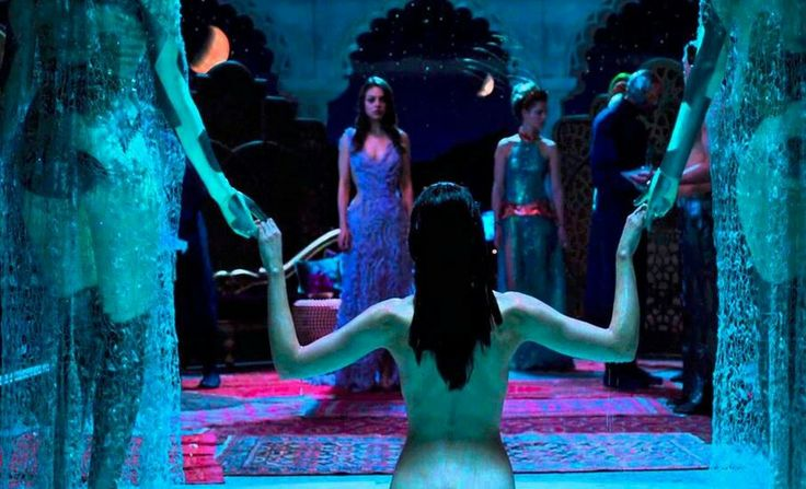 Jupiter ascending - scene with woman stepping out of pool, Her twenty-something youth completely restored.