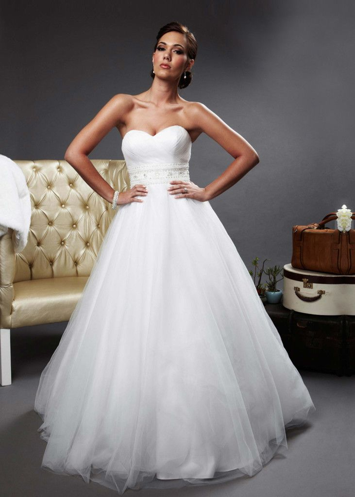 The art of the waist. Designed by Oleg Cassini, this soft white #wedding gown has all the most flattering elements: sweetheart neckline, beaded belt and full, tulle skirt. Click to Book a Free Fitting