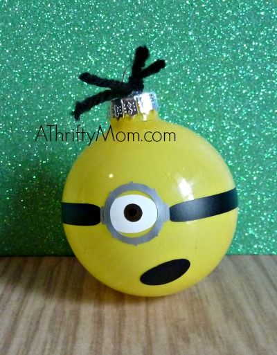 diy christmas ornament~ minion,.. (this could be done with glitter or filled with loose garland too probably)
