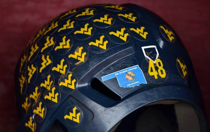 The WVU Baseball team pays respect to the people of Oklahoma with this decal on their batting helmets during the Big 12 Baseball Tournament. #WVU