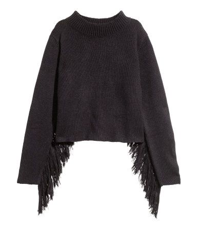 Short, black knit turtleneck sweater in a soft wool blend with fringe along undersides of sleeves.  | H&M Divided