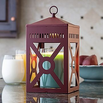 This barn red lantern can go modern or country. A soft halogen bulb creates a warm glow of light through the geometric shapes. Uses our patented top down warming technology with your favorite scented candle. Also available in rustic brown.