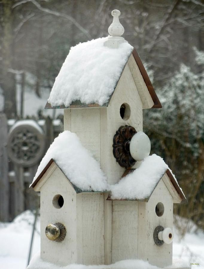 Buy cheap Dollar store bird houses and glue them together, add old knobs.