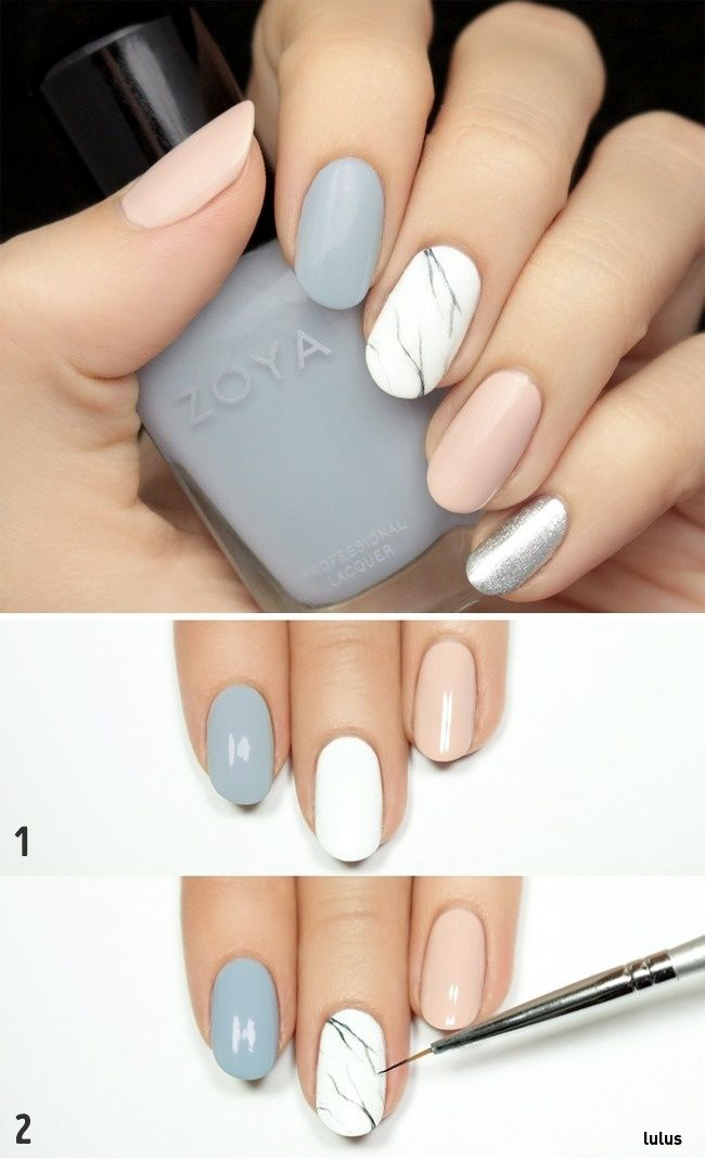 Use a liner brush if you want to embellish your nails with an intricate marble pattern, as shown above.