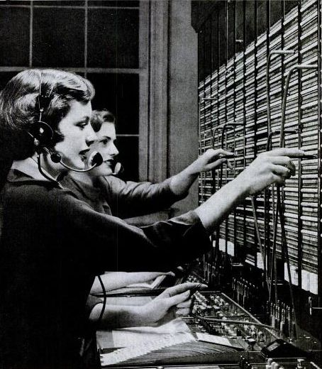 telephone operators, 1950s.  You had to tell the operator the phone number you wanted to call.  or the person's name, if it was a really small town
