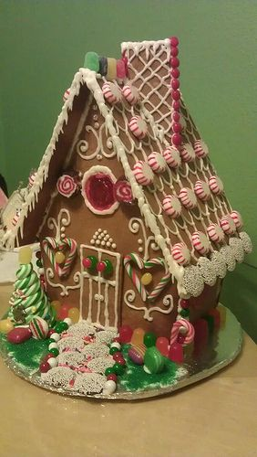 I used the Elfin Cottage pattern from the 1982 Wilton Celebrate!: Christmas book. This is the biggest Gingerbread House I've ever made!